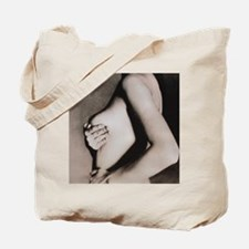 Woman palpates breast during self-examina Tote Bag