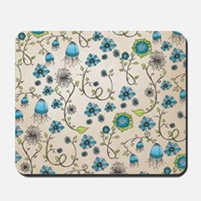 Whimsical blue flowers on beige Mousepad