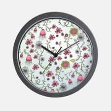 Whimsical pink flowers on blue Wall Clock