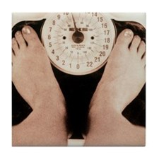 Woman's feet on a set of weighing sca Tile Coaster