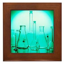 Assortment of empty laboratory flasks Framed Tile