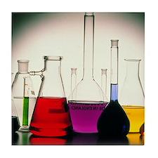 Assortment of laboratory flasks holdi Tile Coaster