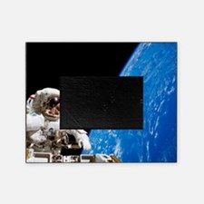 Astronaut performing a spacewalk Picture Frame