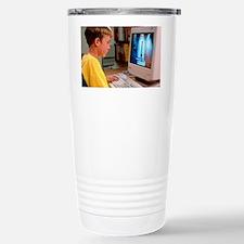 Boy using a multimedia  Travel Mug