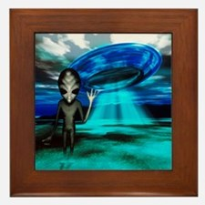 Computer artwork of an alien and a UFO Framed Tile