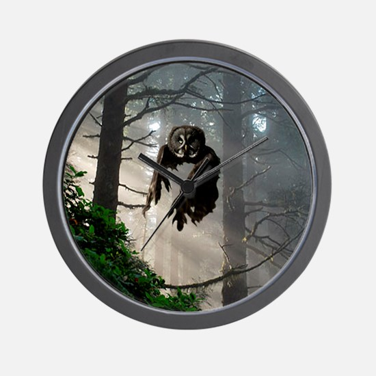 Owl flying out of forest Wall Clock