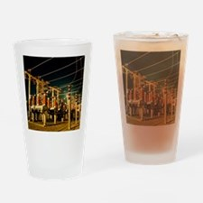 Electricity substation at night Drinking Glass