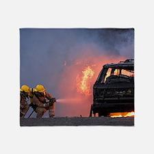 Firefighters hosing a burning car Throw Blanket