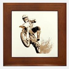 Dirt bike wheeling in mud Framed Tile