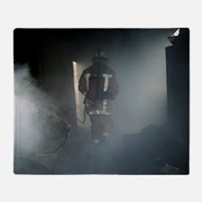 Fire fighter in a burnt house Throw Blanket