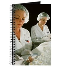 Female technicians counting pills into a b Journal