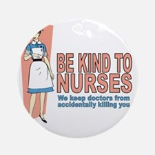 Be kind to nurses... Round Ornament