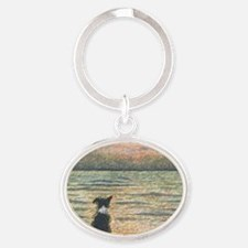 A Border Collie dog says hello to th Oval Keychain