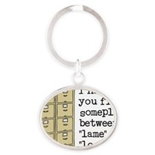 Filed Between Lame And Loser Funny T Oval Keychain