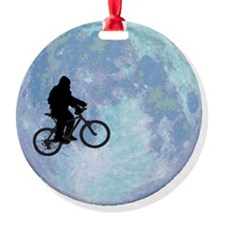 Sasquatch On Bike In Sky Against Mo Round Ornament