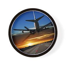 XL jumbo jet airplane landing at sunset Wall Clock
