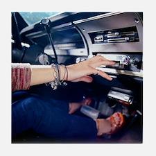 Woman Using Car Stereo Tile Coaster
