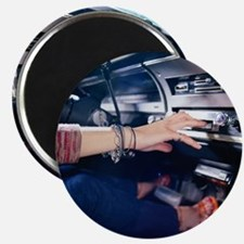 Woman Using Car Stereo Magnet