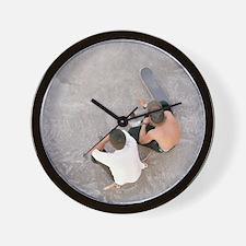 Two teenagers sat in skate park, aerial Wall Clock