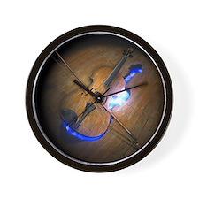 Violin leaving mold in wooden floor, il Wall Clock