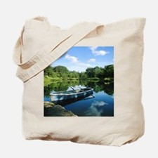Row boat in pond Tote Bag