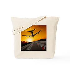 Jumbo jet airplane landing at sunset Tote Bag