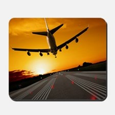 Jumbo jet airplane landing at sunset Mousepad