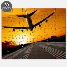 Jumbo jet airplane landing at sunset Puzzle