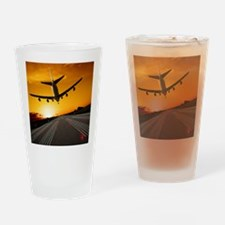 Jumbo jet airplane landing at sunse Drinking Glass