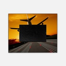 Jumbo jet airplane landing at sunset Picture Frame