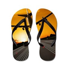 Jumbo jet airplane landing at sunset Flip Flops