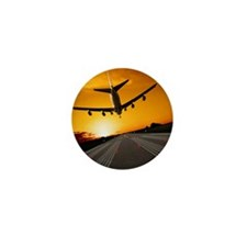 Jumbo jet airplane landing at sunset Mini Button
