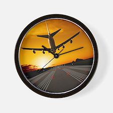 Jumbo jet airplane landing at sunset Wall Clock