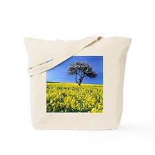 tree in field Tote Bag