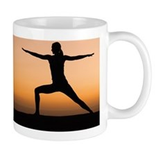 Silhouette of woman doing yoga Mug