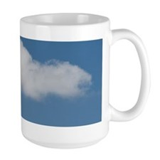 Single cloud in blue sky Mug