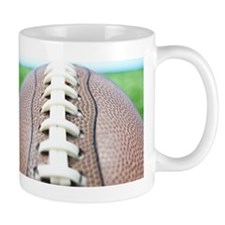 Football on grass, close-up Mug
