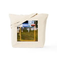 Football in Mid-Air Tote Bag
