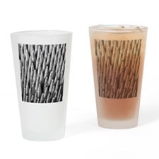 A collection of waxed wooden fire l Drinking Glass