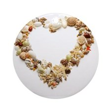 Assorted seashells form heart shape Round Ornament