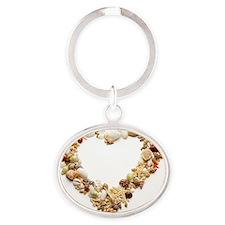 Assorted seashells form heart shape, Oval Keychain