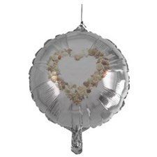 Assorted seashells form heart shape, Balloon