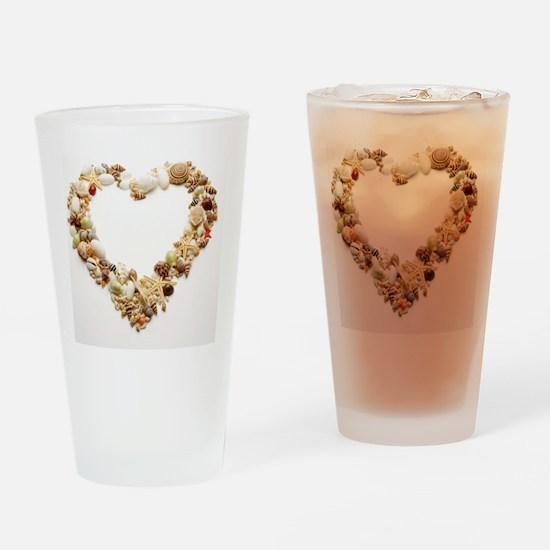 Assorted seashells form heart shape Drinking Glass