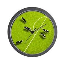 The cows playing soccer Wall Clock