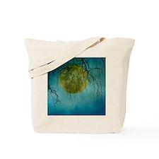 A huge full moon behind bare winter branc Tote Bag