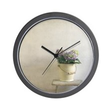 A metal bucket still life on an antique Wall Clock