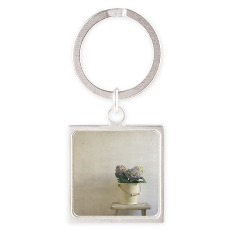 A metal bucket still life on an an Square Keychain