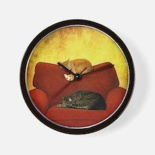 Cats sleeping on sofa. Wall Clock