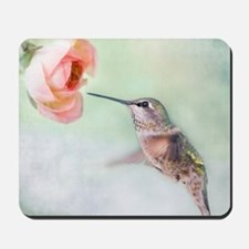 Close up of hummingbird in-flight and pi Mousepad