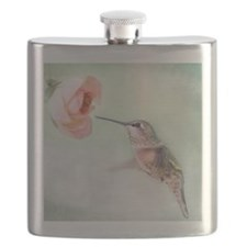 Close up of hummingbird in-flight and pink f Flask